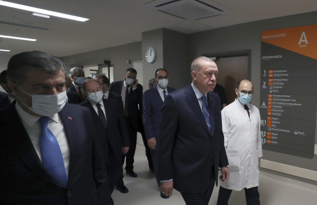 In this photo provided by the Turkish Presidency, Turkey's President Recep Tayyip Erdogan, front center, arrives to attend the inauguration ceremony f...