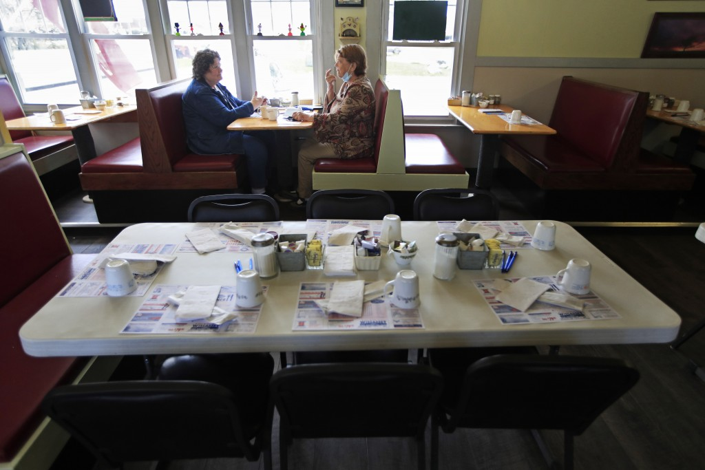 FILE - In this May 18, 2020 file photo, customers dine inside at the Hot Spot Diner in Wiscasset, Maine.  Governor Janet Mills is now allowing restaur...