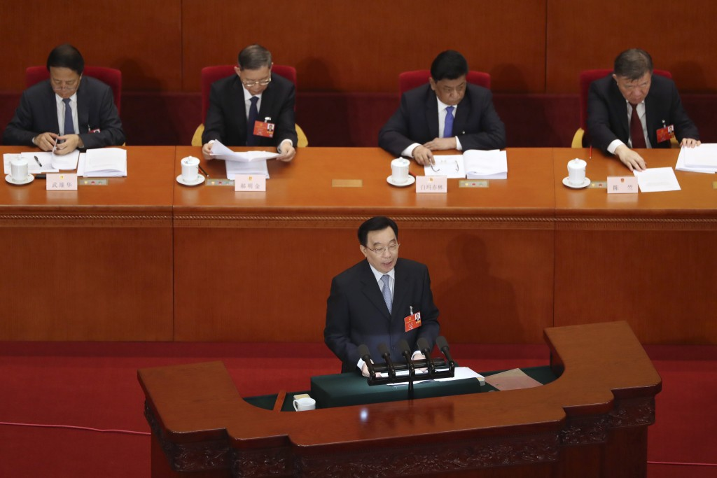 Wang Chen, vice chairman of the Standing Committee of China's National People's Congress (NPC), speaks during the opening session of the NPC at the Gr...