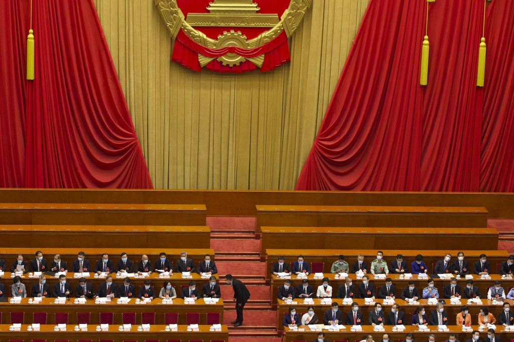 Delegates gather before the start of the opening session of China's National People's Congress (NPC) at the Great Hall of the People in Beijing, Frida...