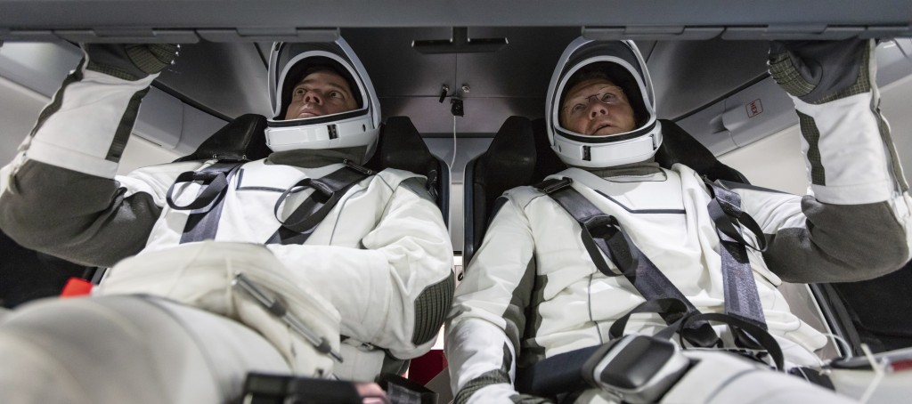 In this August 2018 photo made available by SpaceX, NASA astronauts Doug Hurley and Bob Behnken familiarize themselves with SpaceX's Crew Dragon, the ...