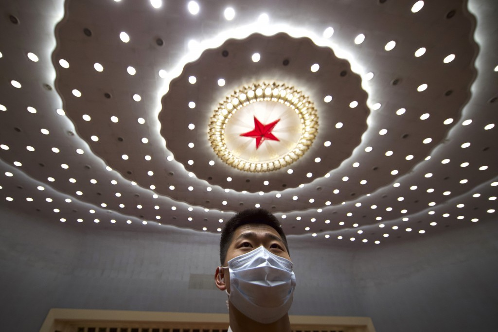 A Chinese security official wearing a face mask stands guard after the opening session of China's National People's Congress (NPC) at the Great Hall o...