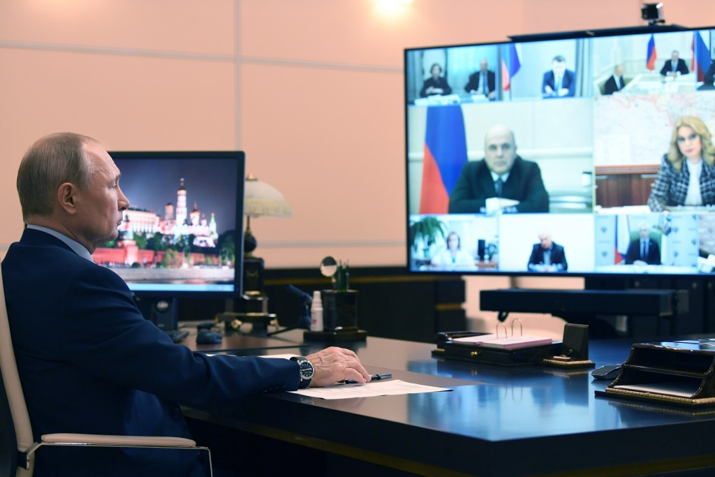Russian President Vladimir Putin attends a cabinet meeting via teleconference at the Novo-Ogaryovo residence outside Moscow Moscow, Russia, Friday, Ma...