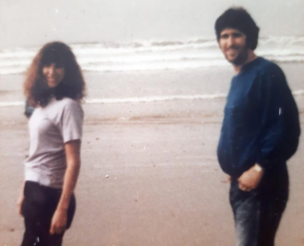This photo provided by Tara Reade, shows Tara Reade and her half-brother Michael Enterline on the beach in Morro Bay, Calif., in 1989. (Tara Reade via...