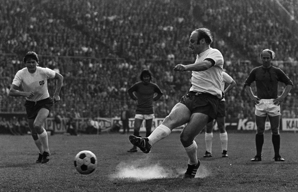FILE - In this May 1, 1972 file photo German soccer star Uwe Seeler shoots a penalty during his farewell match in Hamburg, Germany. Former West German...