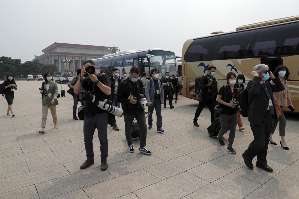Foreign journalists wearing protective face masks to help curb the spread of the new coronavirus arrive to Tiananmen Square to cover the opening cerem...