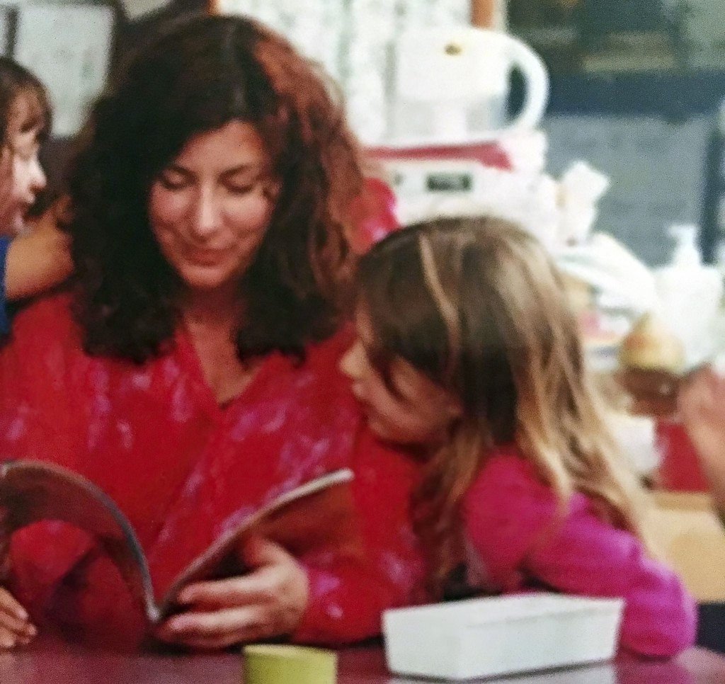 This photo provided by Tara Reade shows Tara Reade reading a book with her seven-year-old daughter at her daughter's school in Seattle, in 2001. (Tara...