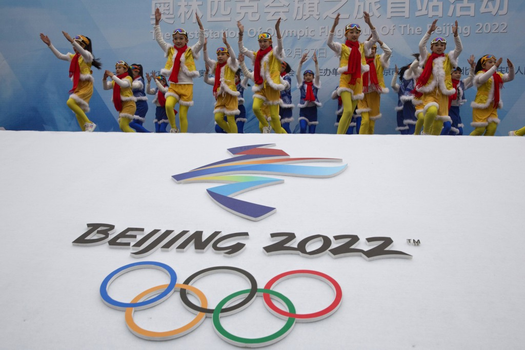 FILE - In this Feb. 27, 2018, file photo, Chinese performers dance during a ceremony to mark the arrival of the Olympic flag and start of the flag tou...