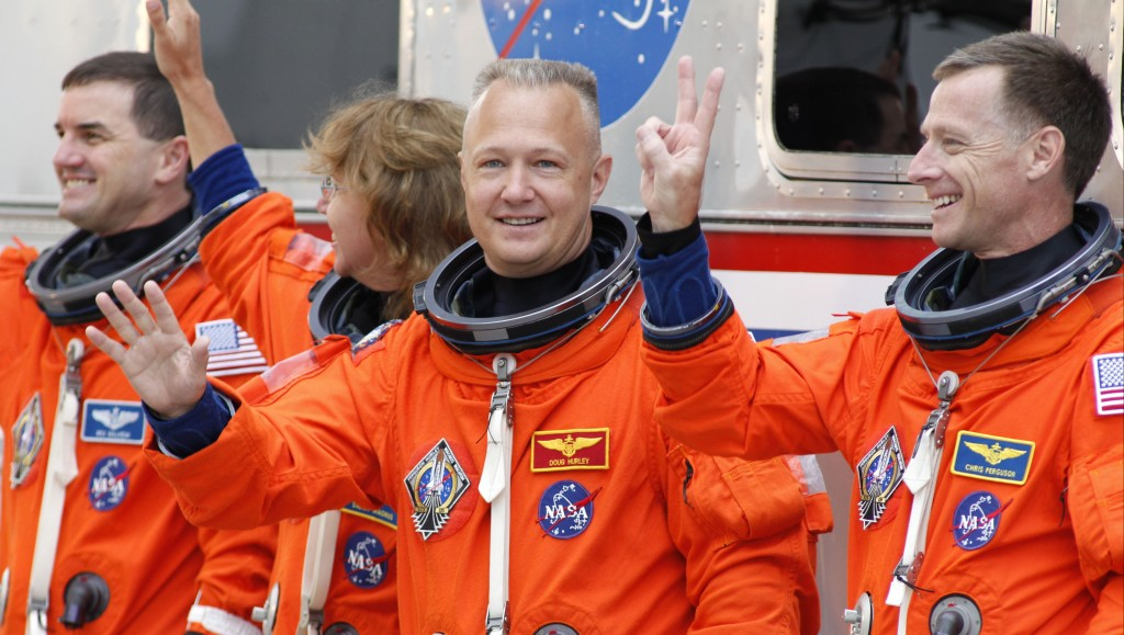 FILE - In this Friday, July 8, 2011 file photo, space shuttle Atlantis astronauts, from left, mission specialists Rex Walheim and Sandy Magnus, pilot ...