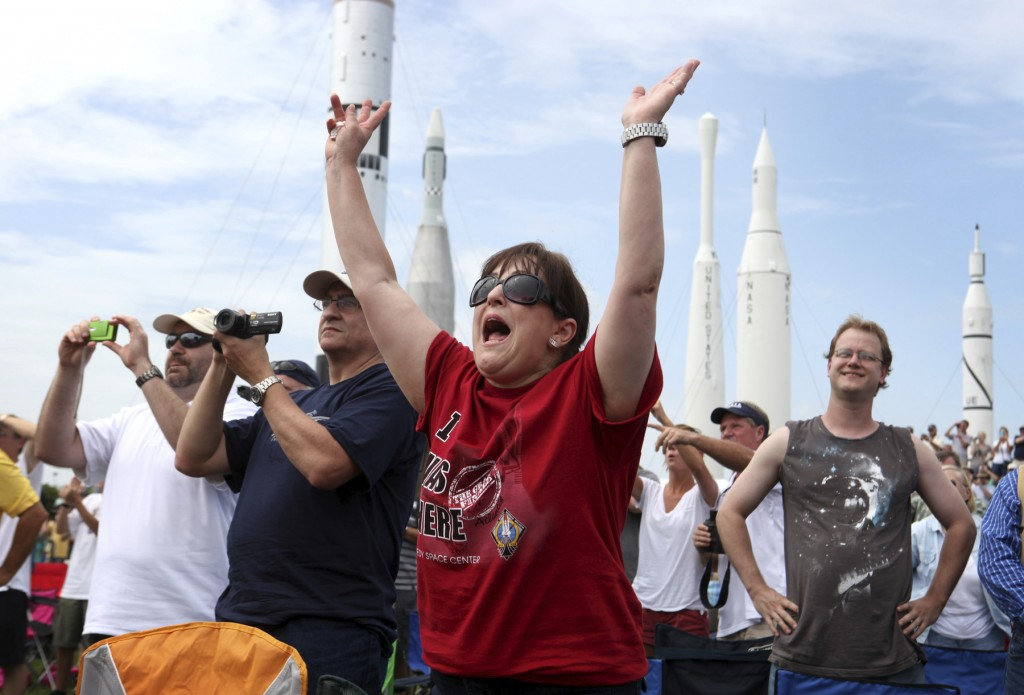 FILE - In this July, 8, 2011 file photo, Vanessa Fabrega, of Austin, Texas, cheers as she and others watch the launch of space shuttle Atlantis from t...