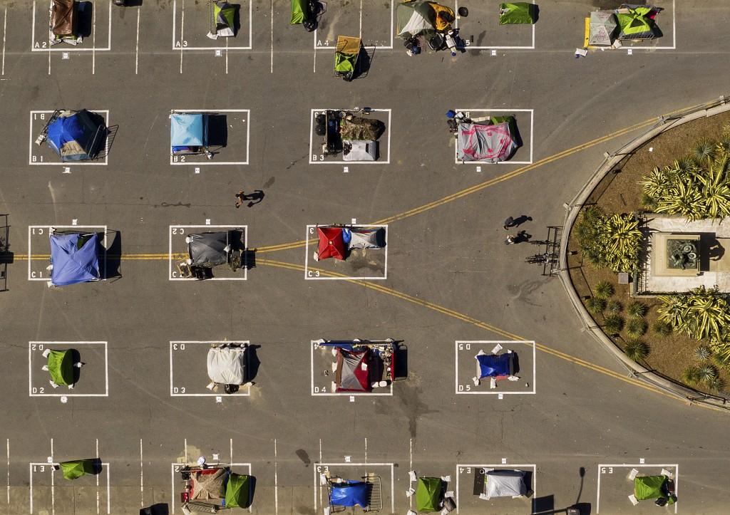 Rectangles designed to help prevent the spread of the coronavirus by encouraging social distancing line a city-sanctioned homeless encampment at San F...
