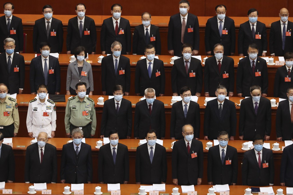 Delegates stand during the opening session of China's National People's Congress (NPC) at the Great Hall of the People in Beijing, Friday, May 22, 202...