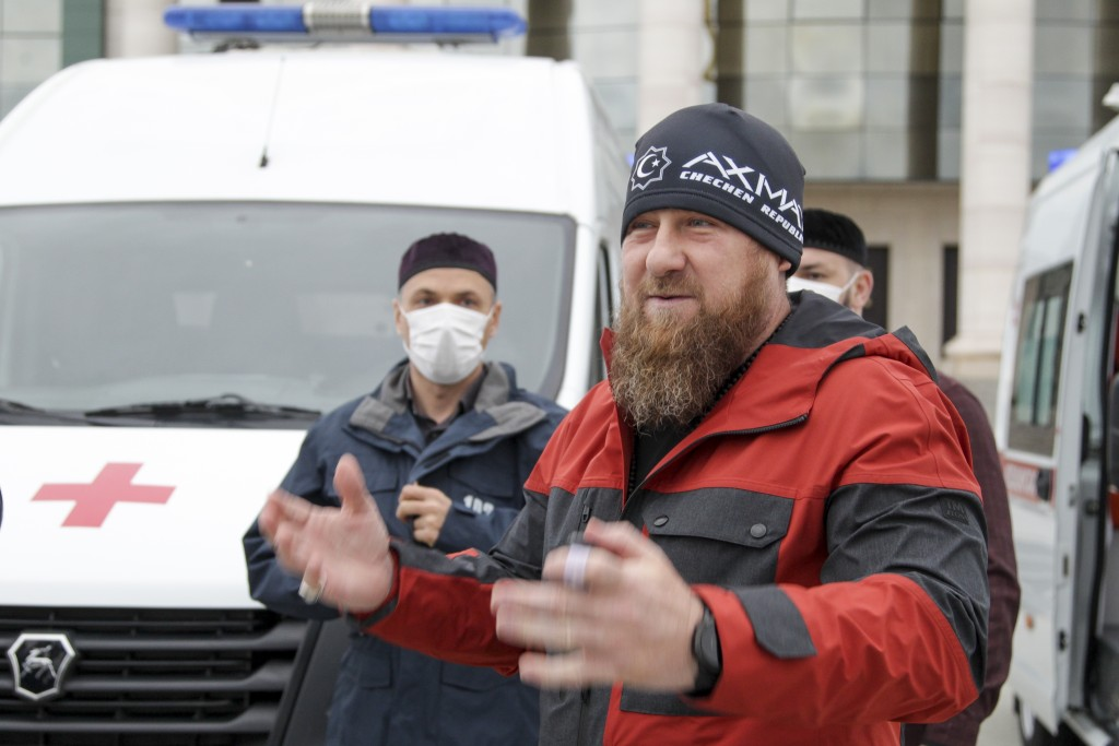 In this photo taken on Saturday, May 9, 2020, Chechnya's regional leader Ramzan Kadyrov speaks to journalists as he presens new ambulance vehicles in ...
