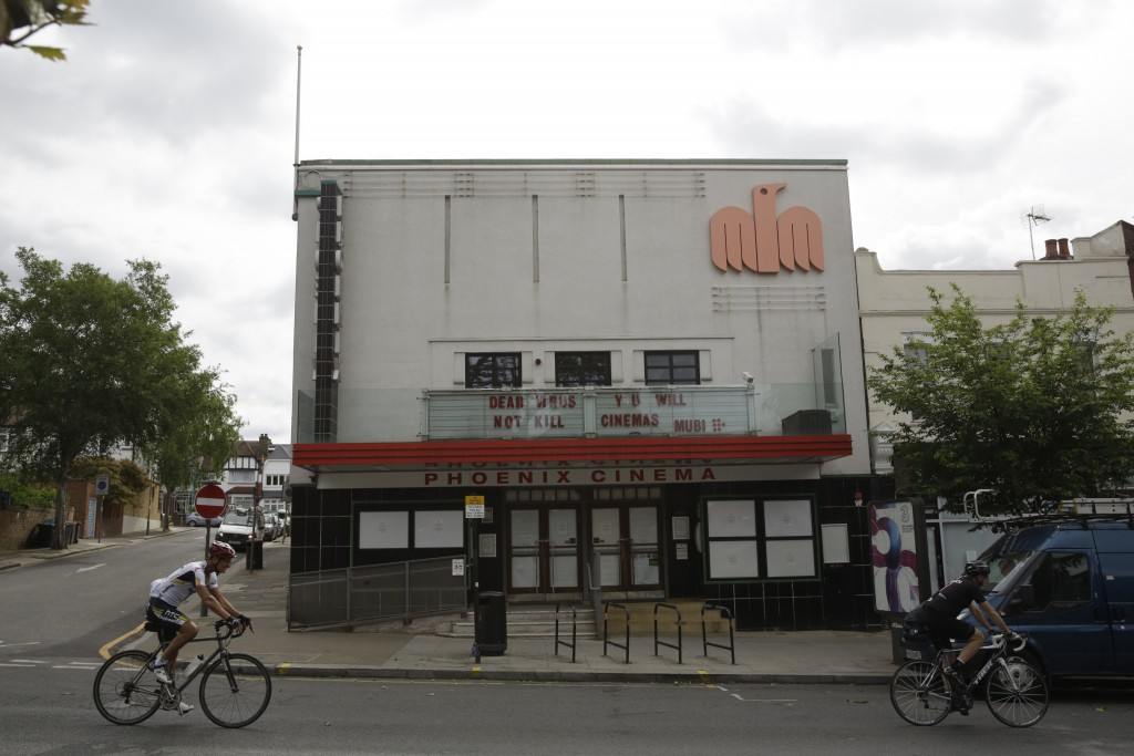The independent Phoenix Cinema with a coronavirus message written where the name of a movie would normally appear, stands temporarily closed as part o...