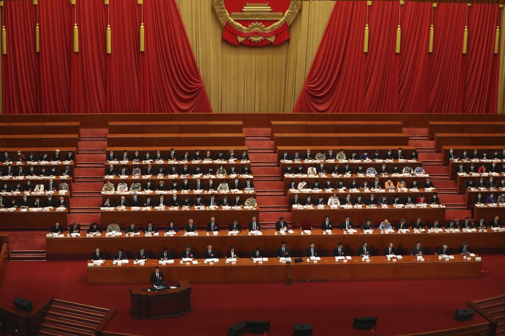 Chinese Premier Li Keqiang delivers the government work report during the opening session of China's National People's Congress (NPC) at the Great Hal...