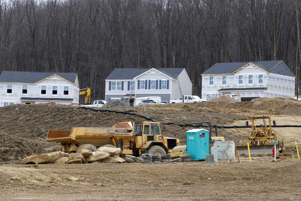 In this March 18, 2020 photo, Construction continues at a housing plan in Zelienople, Pa.,  The housing market has stalled, but homebuilder stocks are...