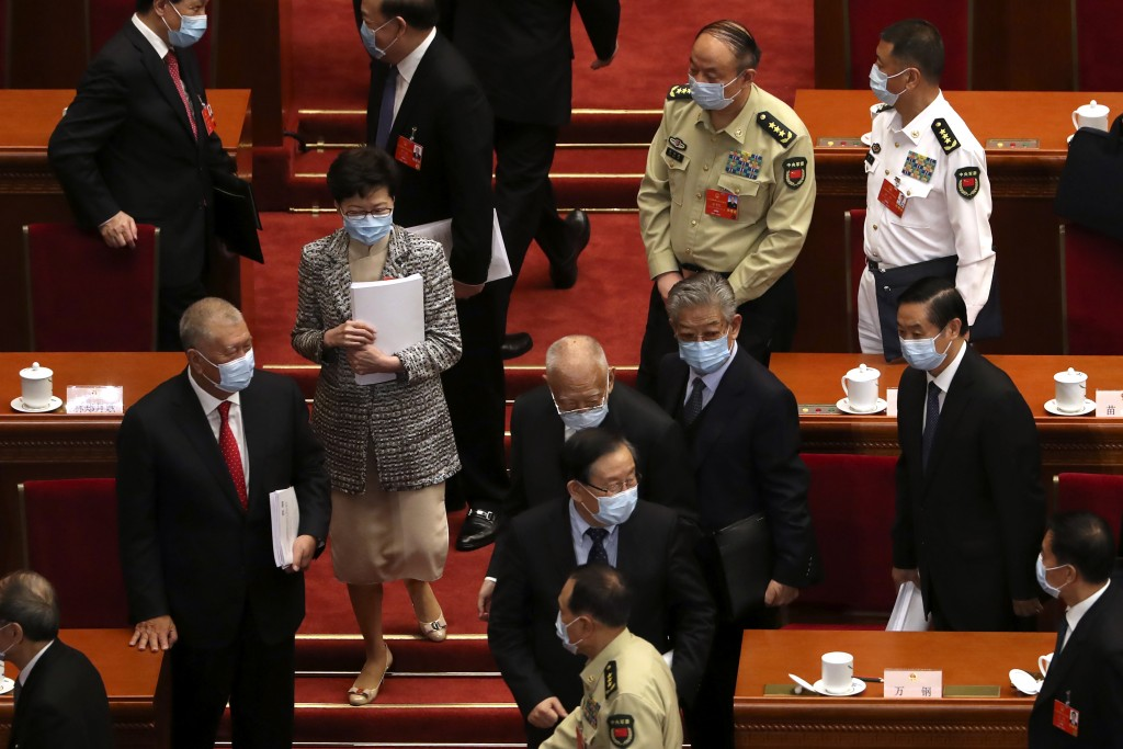Hong Kong Chief Executive Carrie Lam, second from left, leaves after the opening session of China's National People's Congress (NPC) at the Great Hall...