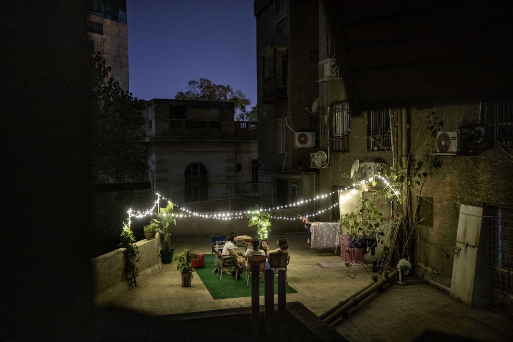 FILE - In this May 4, 2020, file photo, girls gather on a rooftop after Iftar or breaking their fast during Ramadan, in Cairo, Egypt. Muslims worldwid...