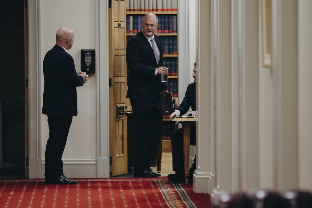 National Party's Todd Muller, right, talks with a colleague ahead of a party caucus meeting in Wellington, New Zealand, Friday, May 22, 2020. Muller o...