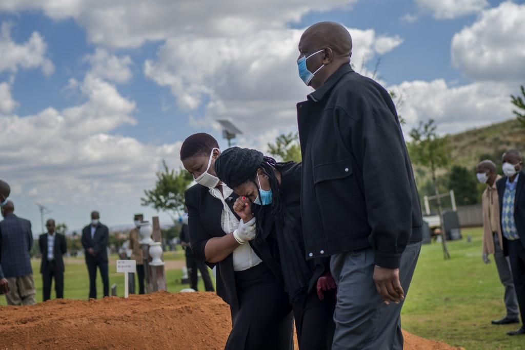 Relatives grieve Benedict Somi Vilakasi at his burial ceremony at the Nasrec Memorial Park outside Johannesburg, April 16, 2020. Vilakasi, a Soweto co...