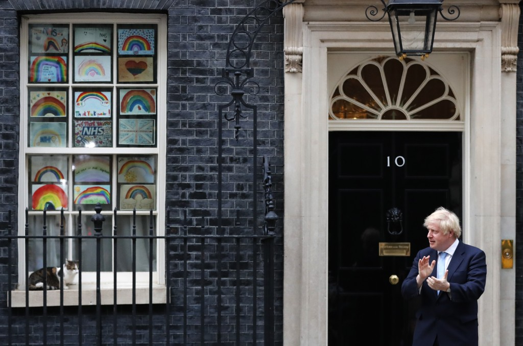 Britain's Prime Minister Boris Johnson stands outside 10 Downing Street to join in the nationwide Clap for Carers to recognise and support National He...
