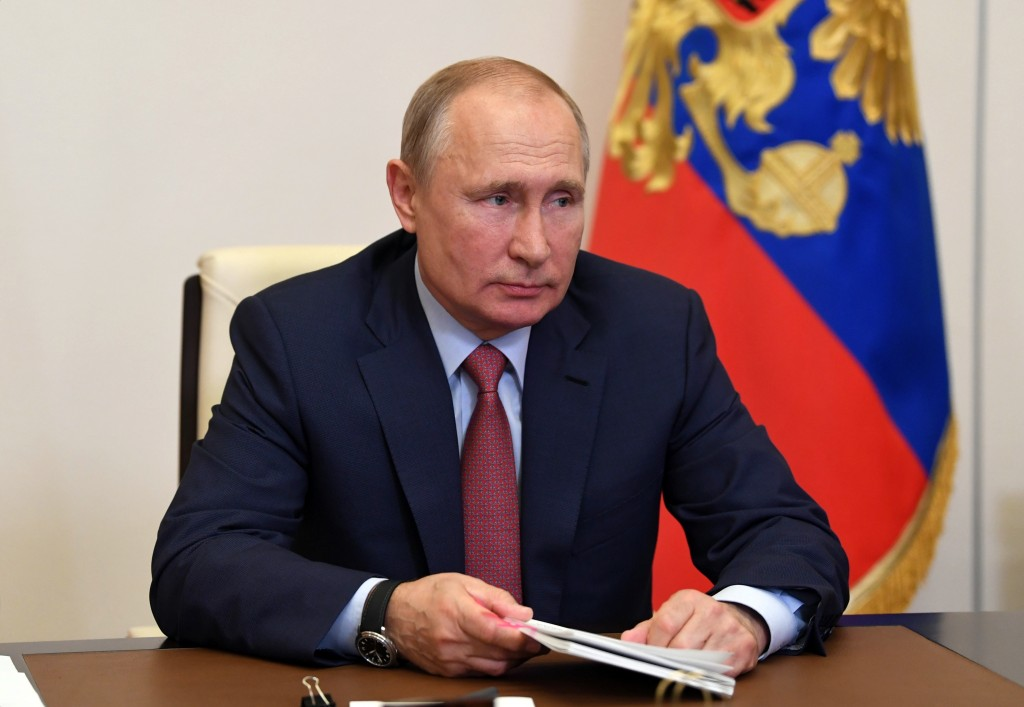Russian President Vladimir Putin attends a meeting on education via teleconference at the Novo-Ogaryovo residence outside Moscow, Russia, Thursday, Ma...