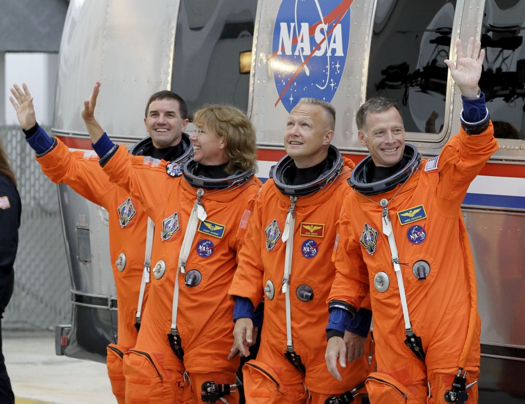 FILE - In this Friday, July 8, 2011 file photo, the crew of the space shuttle Atlantis, from left, mission specialists Rex Walheim and Sandy Magnus, p...