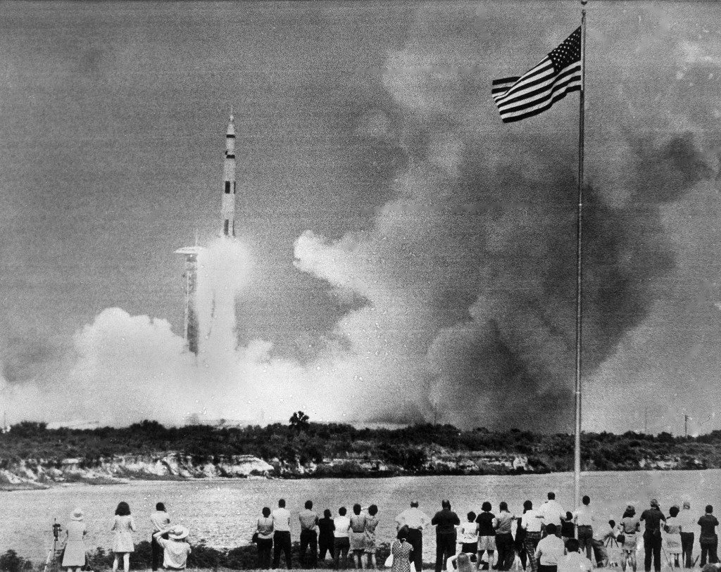 FILE - In this April 11, 1970 file photo, crowds watch the lift-off of the Saturn V rocket carrying the Apollo 13 spacecraft on its mission to the moo...