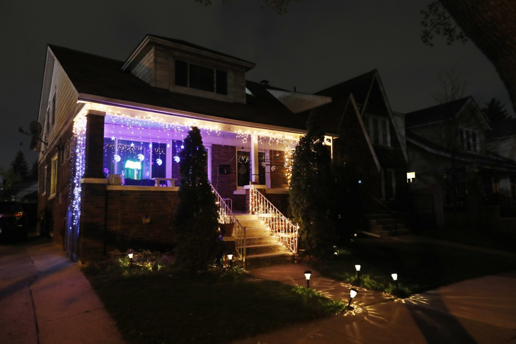 FILE - In a file photo from Tuesday, April 28, 2020, Ramadan lights are displayed on a house in Dearborn, Mich. The Muslim community in Dearborn is st...