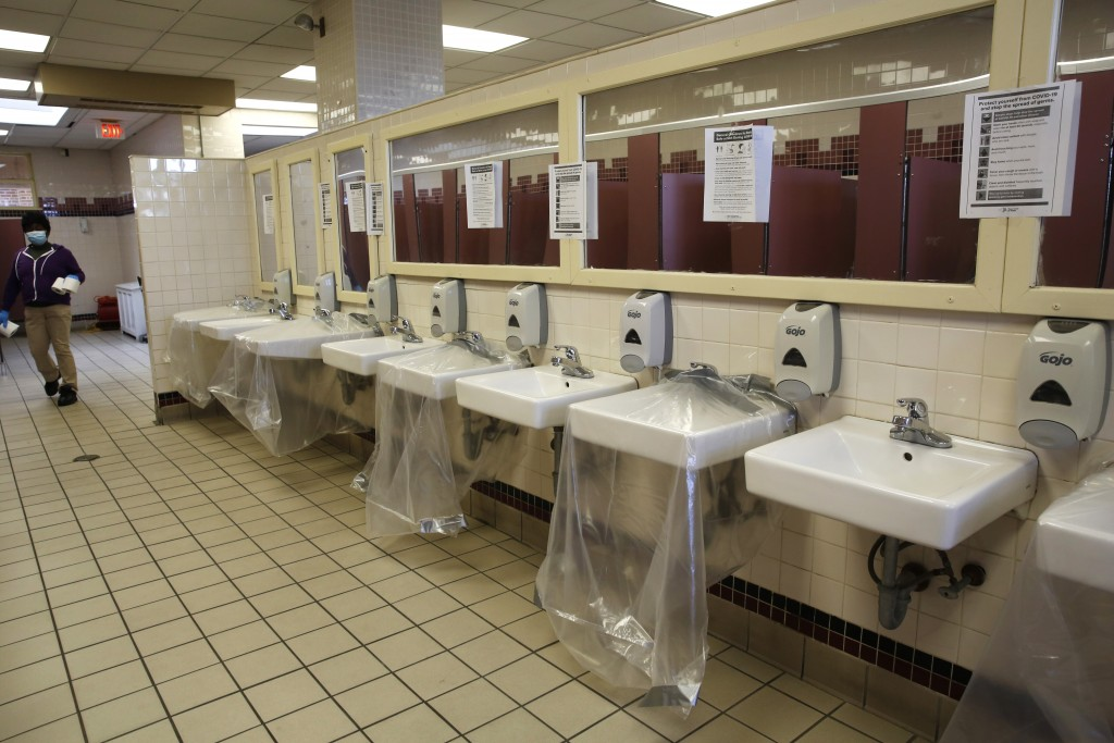 Every other sink in the restroom is covered by sheets of plastic to prevent overcrowding amid the coronavirus pandemic, Thursday, May 21, 2020, at Jon...