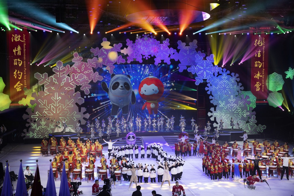 FILE - In this Sept. 17, 2019, file photo, Beijing 2022 Winter Olympic Mascot Bing Dwen Dwen, left on screen and 2022 Winter Paralympic Games mascot S...