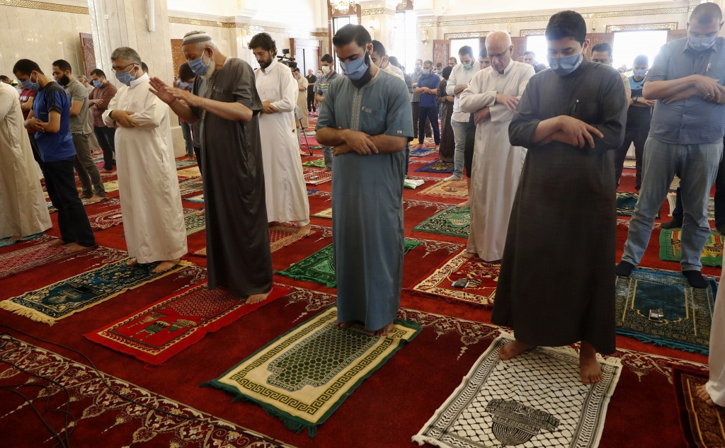 Palestinian worshippers wear protective face masks at the last Friday prayer of the holy fasting month of Ramadan, to prevent the spread of coronaviru...