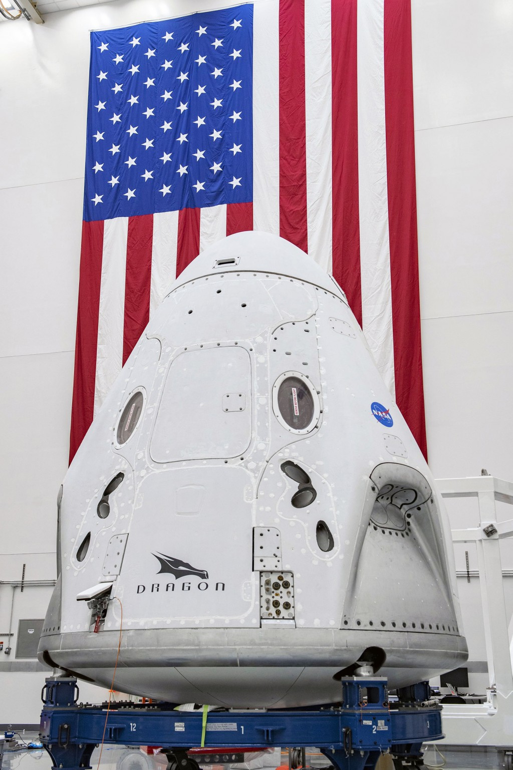 In this April 10, 2020 photo made available by SpaceX, The SpaceX Crew Dragon spacecraft undergoes final processing at Cape Canaveral Air Force Statio...