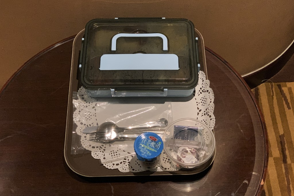 Breakfast in a sealed box, delivered by tray to squat tables is placed outside the hotel room which assigned for journalist who was selected to cover ...