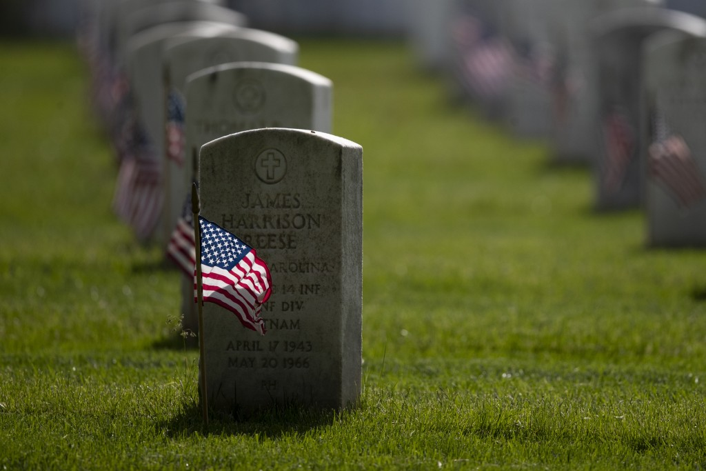 """American flags are placed by members of the 3rd U.S. Infantry Regiment, also known as The Old Guard, in front of each headstone for """"Flags-In"""" at Arli..."""