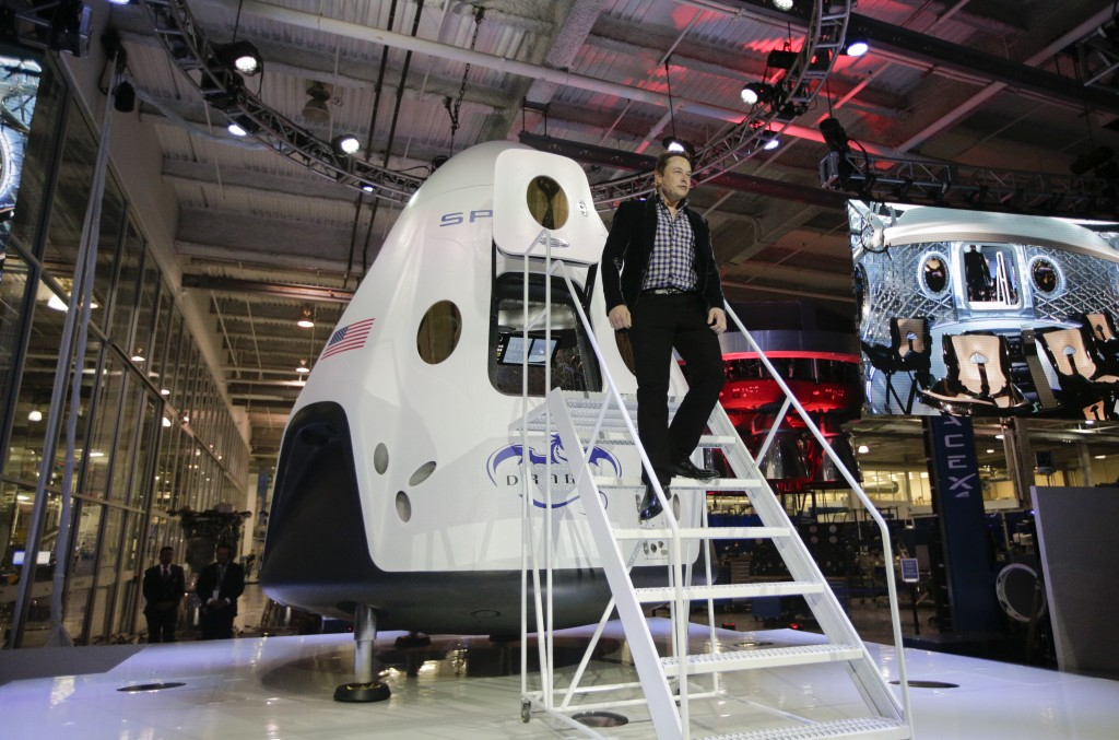 FILE - In this Thursday, May 29, 2014 file photo, Elon Musk, CEO and CTO of SpaceX, walks down the steps during the introduction of the SpaceX Dragon ...