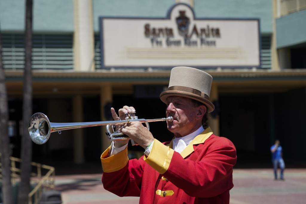 "In this Friday, May 22, 2020 photo, bugler Jay Cohen blows ""Call to the Post"" to the empty grandstand, a tradition maintained for those watching via s..."