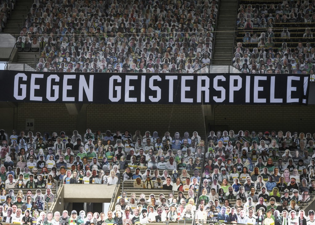 "A banner reading ""against ghost matches"" is pictured aheadthe German first division Bundesliga football match Borussia Moenchengladbach and Bayer 04 L..."