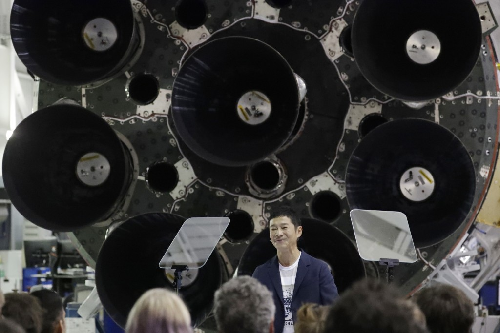 FILE - In this Monday, Sept. 17, 2018 file photo, Japanese billionaire Yusaku Maezawa speaks after SpaceX founder and chief executive Elon Musk announ...