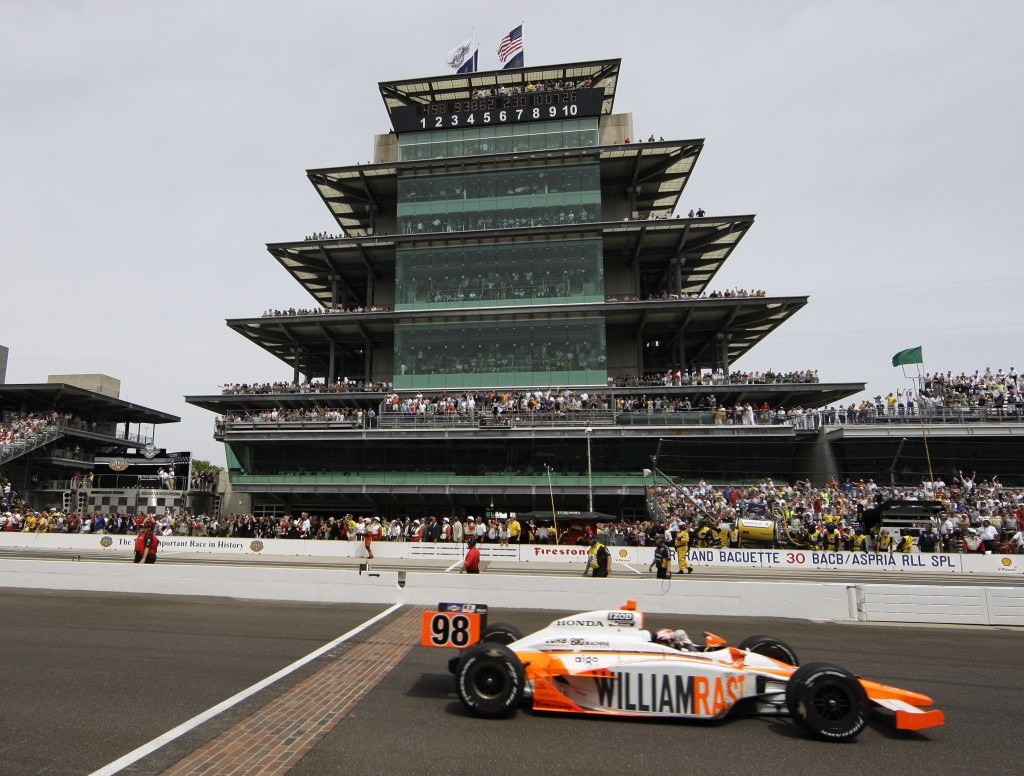FILE - In this May 29, 2011, file photo, IndyCar driver Dan Wheldon, of England, crosses the finish line to win the Indianapolis 500 auto race at the ...