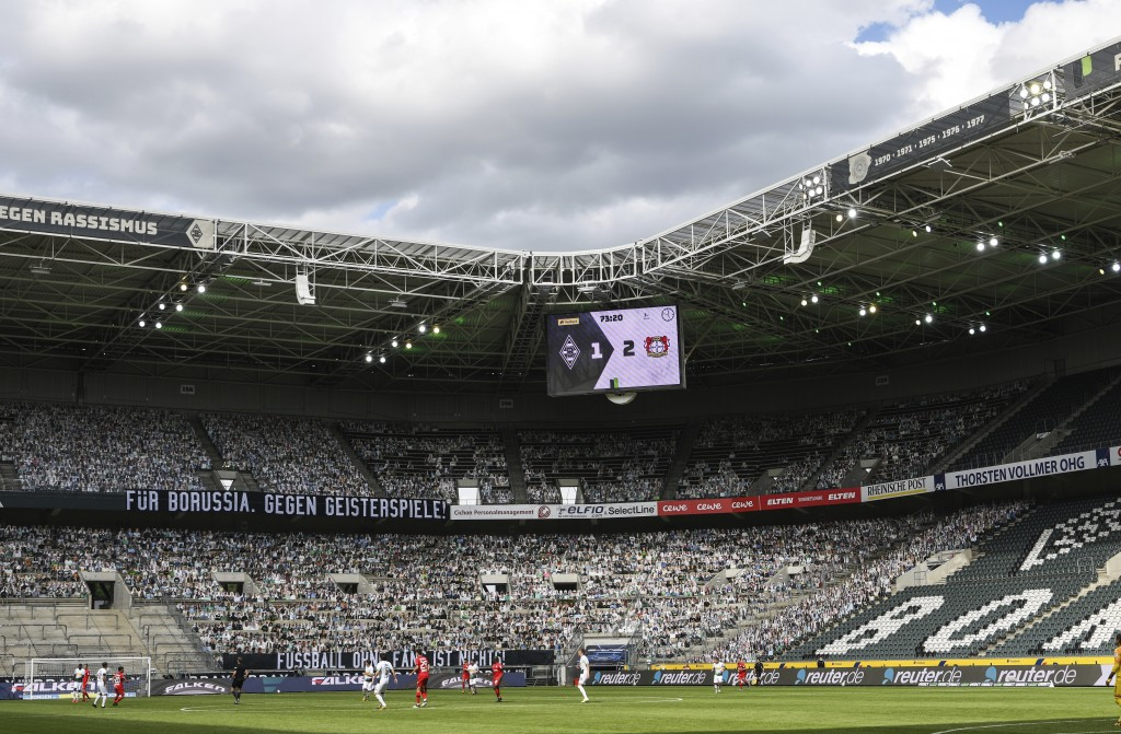 """A banner reading """"For Borussia, against ghost matches"""" is displayed during the German Bundesliga soccer match between Borussia Moenchengladbach and Le..."""