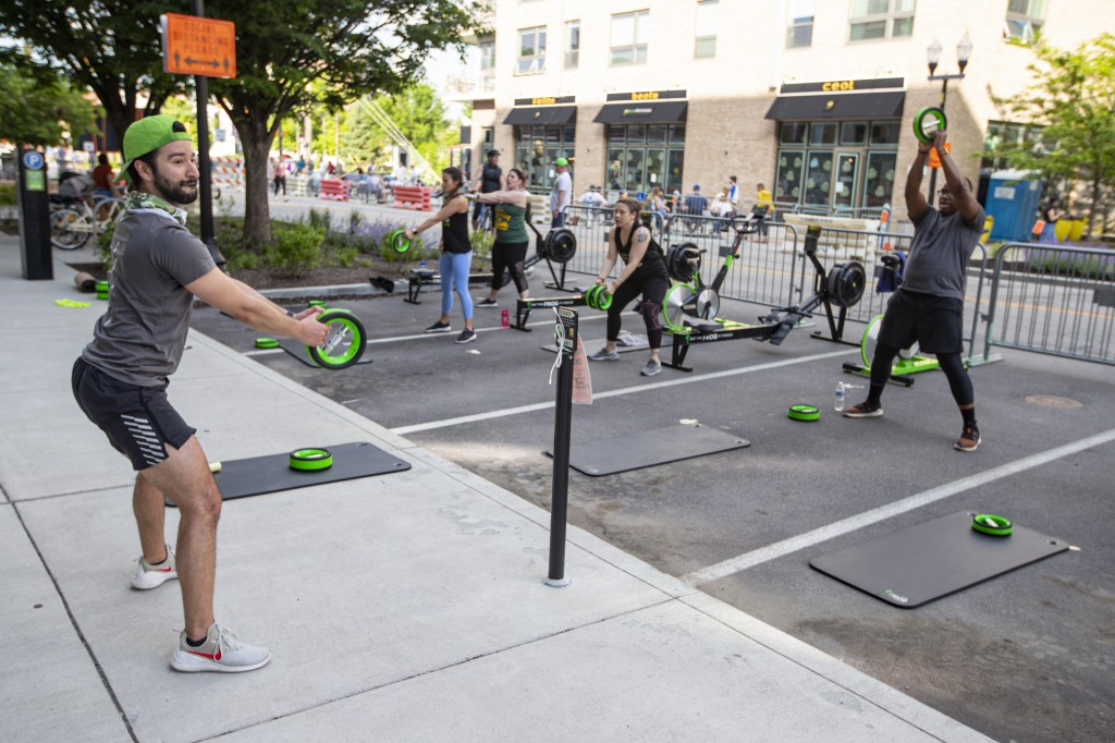 Jacob Morden leads a fitness class on a closed street in downtown Indianapolis, Friday, May 22, 2020. The city closed several streets to traffic to ac...