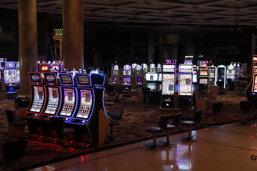 Chairs have been removed at some electronic slot machines to maintain social distancing between players at a closed Caesars Palace hotel and casino Th...