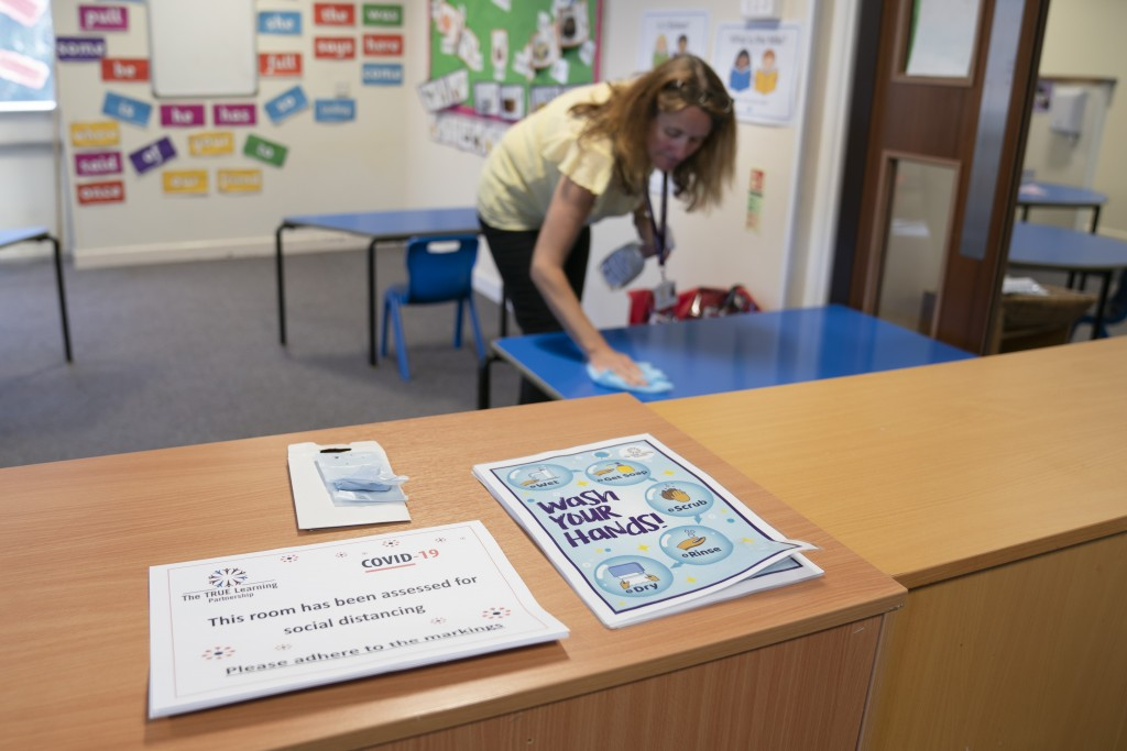 Reception teacher Elizabeth Dockry cleans her classroom as measures are taken to prevent the transmission of coronavirus before the possible reopening...
