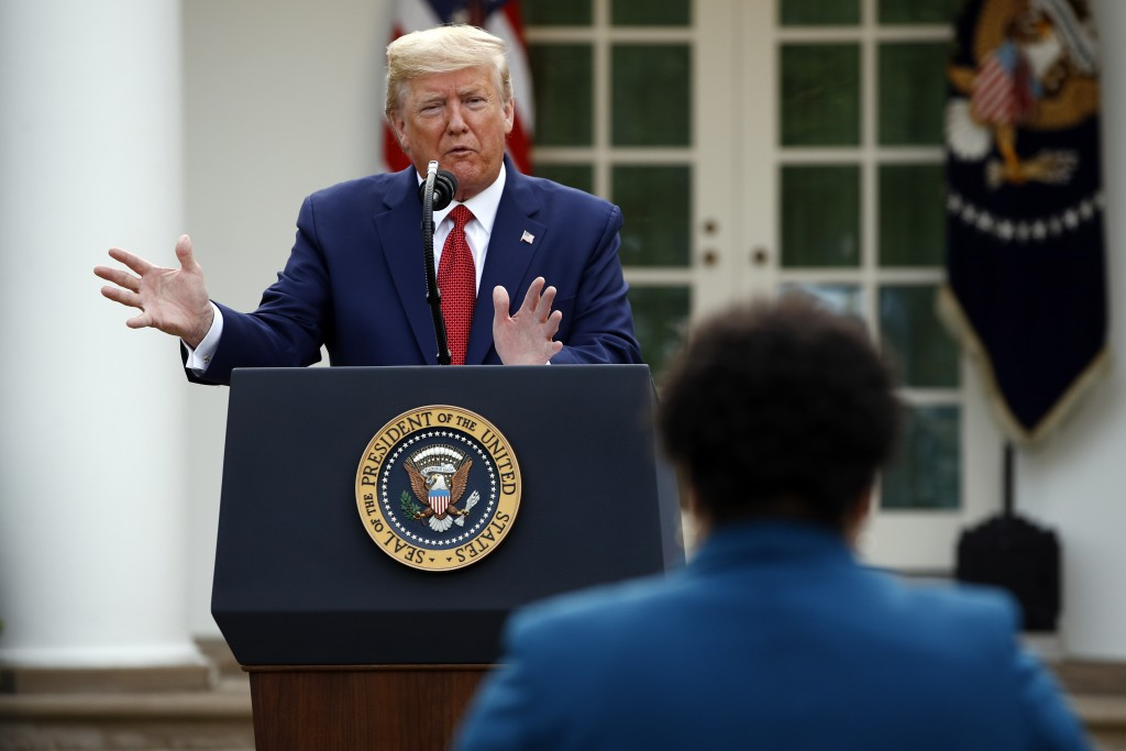 FILE - This March 29, 2020 file photo shows President Donald Trump answering a question from PBS reporter Yamiche Alcindor during a coronavirus task f...