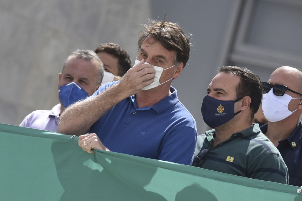 FILE - In this May 17, 2020 file photo, Brazil's President Jair Bolsonaro, wearing a protective face mask as a precaution against the spread of the ne...