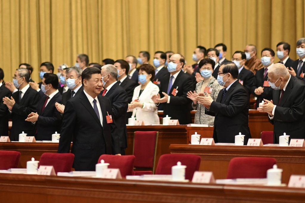 Delegates applaud as Chinese President Xi Jinping arrives at China's National People's Congress.