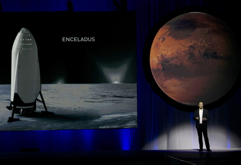 FILE - In this Tuesday, Sept. 27, 2016 file photo, SpaceX founder Elon Musk speaks during the 67th International Astronautical Congress in Guadalajara...