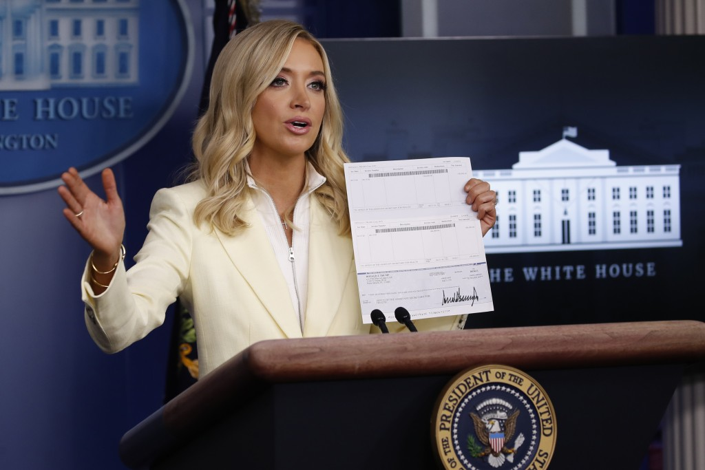 White House press secretary Kayleigh McEnany speaks with reporters about the coronavirus in the James Brady Briefing Room of the White House, Friday, ...