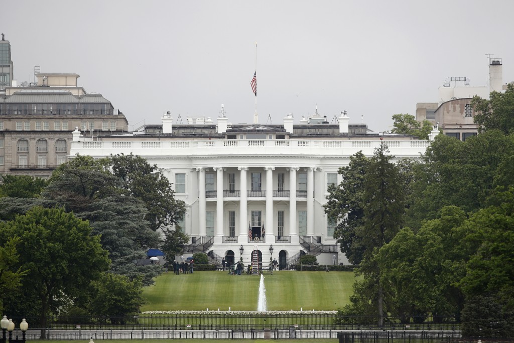 FILE - In this May 22, 2020, file photo, an American flag flies at half-staff above the White House in Washington.As a candidate for the White House, ...